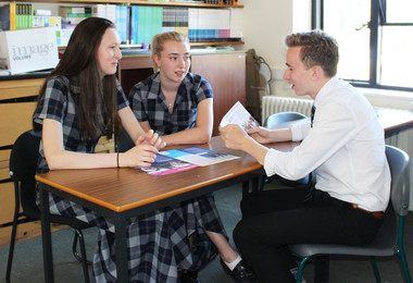 Sixth Form students discussing Alzheimer Society leaflets