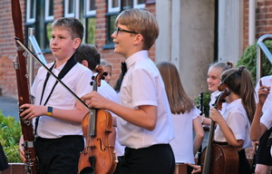 Prep School musicians outside Mem Hall Picnic Concert 2018