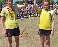 Westfield boy and girl with prep school sports day trophy