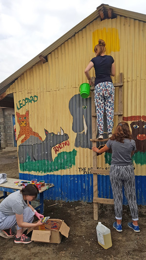 Painting school wall on Kenya trip 2018