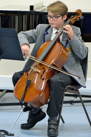 Form 2 boy playing the cello