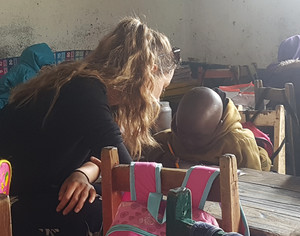 Sixth Form girl working with boy on Kenya Trip