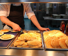 Hot food on display in dining hall