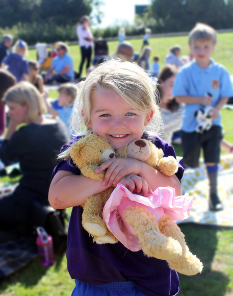 Girl with teddy at teedy bears picnic