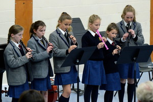 Girls playing recorder