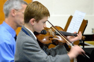 Independent Prep School boy playing violin