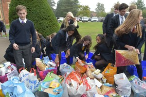 Senior School & Sixth Form pupils with Harvest Offerings