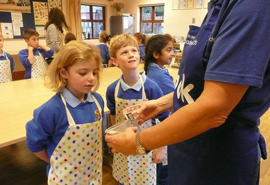 Year 2 pupils at Barleylands making butter