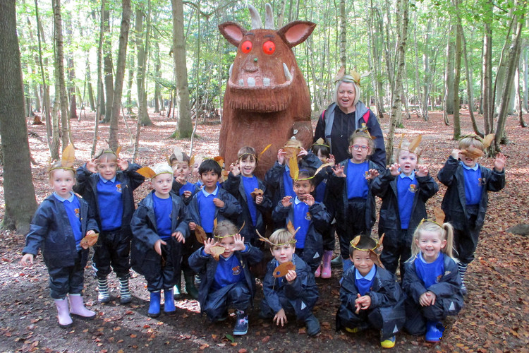 Reception pupils with the gruffalo sculpture