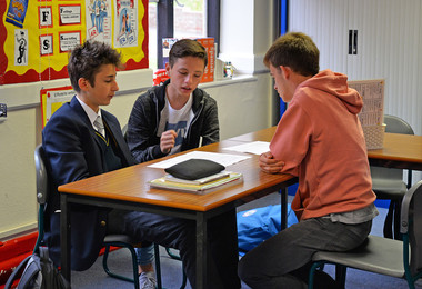 Spanish boys with college pupil in lesson