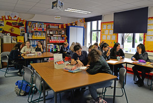 Spanish pupils with college pupils in classroom