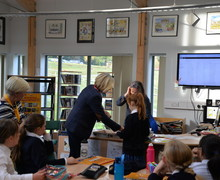 Mrs Mullender presents Form 2 Curiosity Club badge