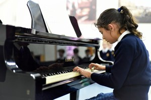 Pianist performing in Form 2 concert