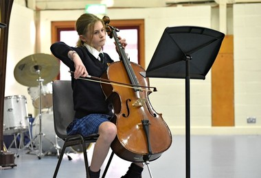 Cellist performing in Form 2 Concert