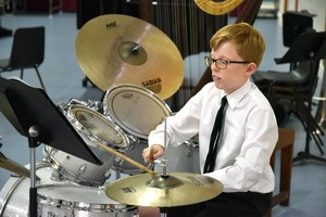 Drummer performing in Form 2 Concert