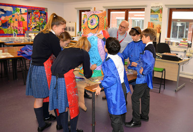 Prep school artists painting owl with james mayhew