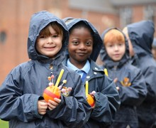 Pre-Prep pupils holding oranges for Christingle