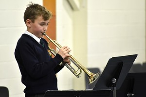 Lower Third trumpeter performs in concert