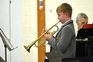 Boy performs on Trumpet in Lower Third concert