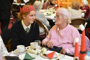 Pupil chatting with guest at OAP lunch in FLT 2018