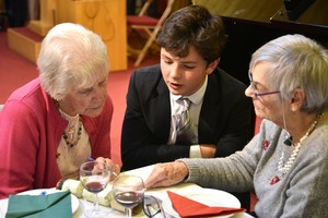 Senior School Pupil entertaining guests at OAP mxas lunch