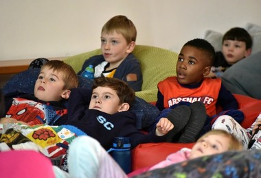 Pre-Prep pupils on beanbags watching a film together