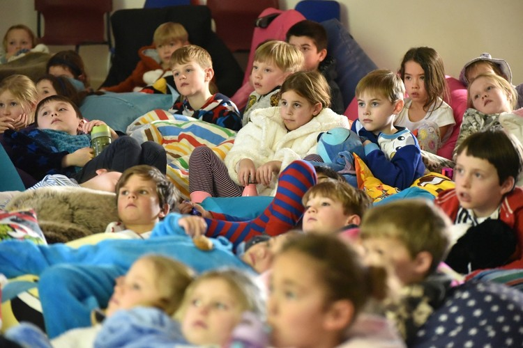 Group of Pre-Prep pupils watching film on beanbag night