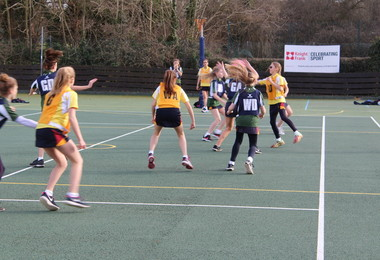 Prep School netball with Knight Frank logo