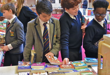 Prep School boys looking at books at book fair 2019