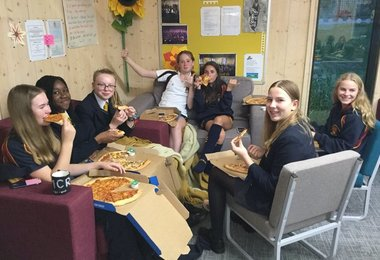 Boarders enjoy Pizza in Trotman house