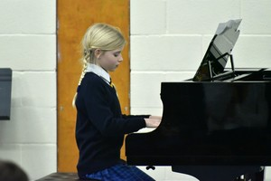 Form 1 pupil on piano in F1 Concert Feb 19