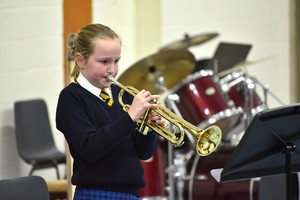 Girl on trumpet in Form 1 Concert Feb 19