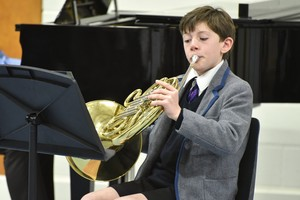 Boy on French Horn in Form 1 Concert Feb 19