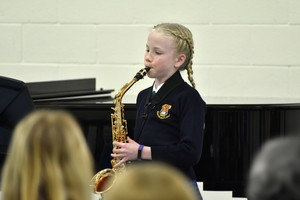 Saxophonist player in Form 1 Prep School Concert