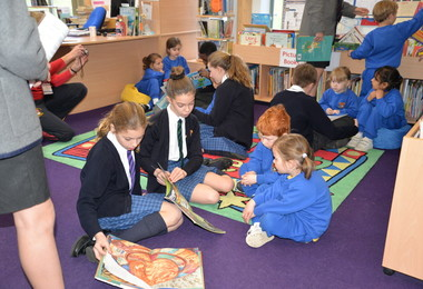 L3 pupils reading with Reception on World Book Day