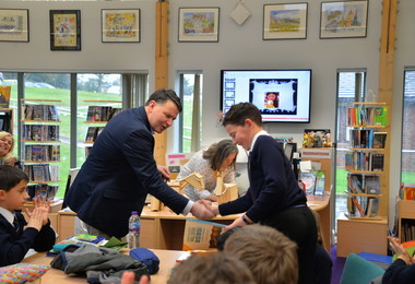 Form 2 pupil receives Curiosity Club badge in Prep School Library