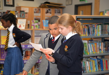 Lower Third examine clues in Prep School Library