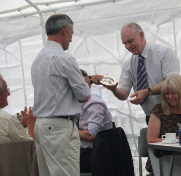 Headmaster receiving retirement gift from OCs, July 2015