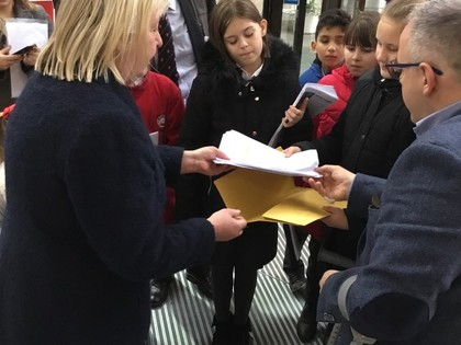 Children present library petition