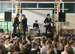 Children rock out to the Beatles