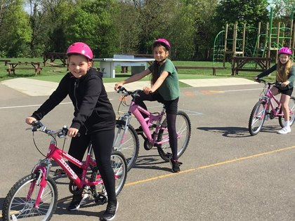 Children learn to ride bikes safely