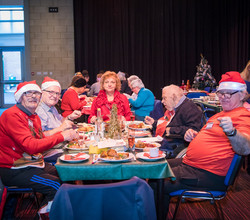 Age UK Guests Enjoy Christmas Lunch with Students