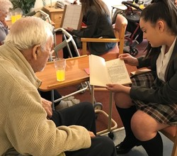 Students Read to Residents at Oaks Care Home