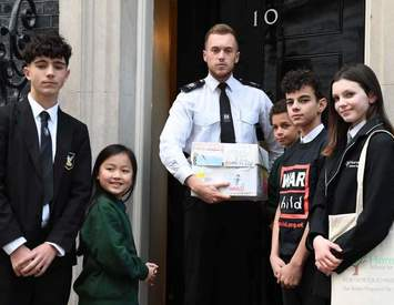 Our pupil delivered petition to Downing Street with 12,000 pleas to help children at war stricken countries