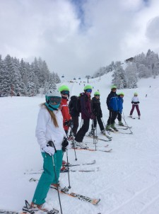 Students lined up with skis