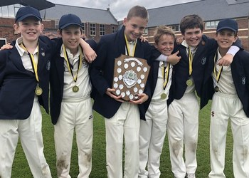Under-11 cricketers retain trophy