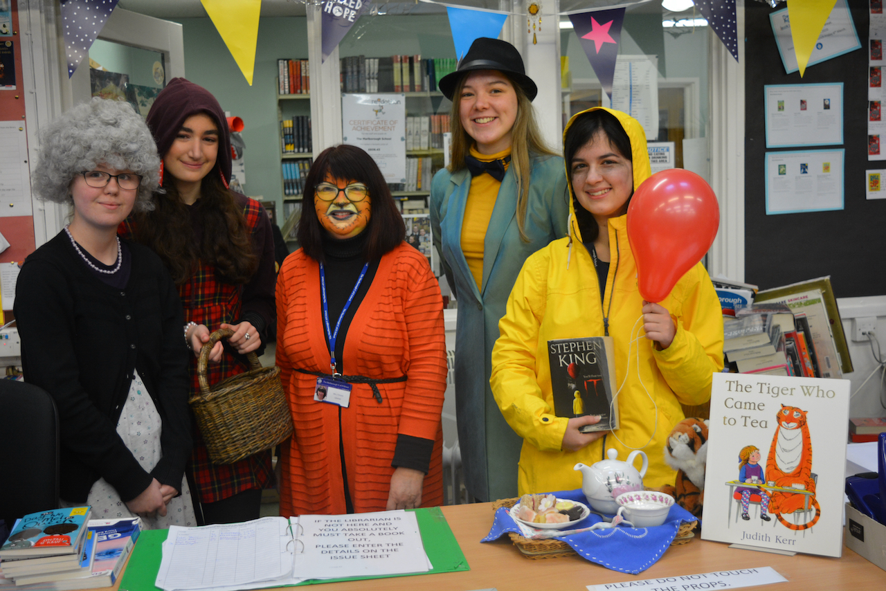Mrs Onions and Sixth Form Students in fancy dress for World Book Day