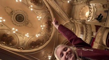 Alice Inspects Her Great, Great Grandfather's artwork at The Kings Theatre