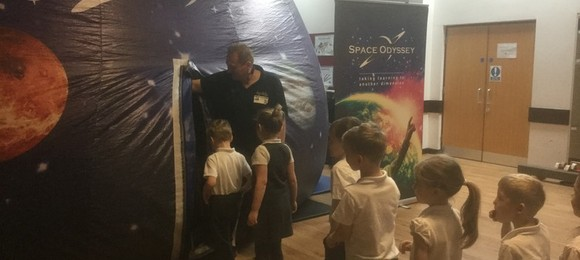 Year 1, 5 and 6 have been treated to a fabulous Planetarium experience.  This photo shows the year 1's entering into space!