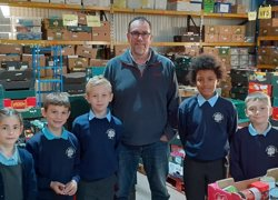 Children work at foodbank for harvest